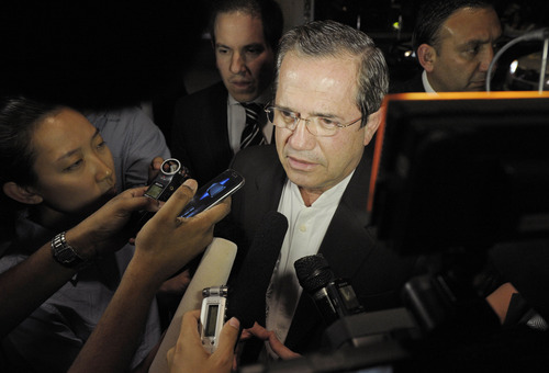 Ecuador's Foreign Minster Ricardo Patino speaks to members of the media as he arrives for a reception at Singapore's Shangri-la Hotel on Thursday, June 27, 2013.  (AP Photo/Joseph Nair)
