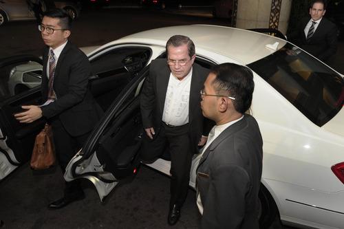 Ecuador's Foreign Minster Ricardo Patino arrives for a reception at Singapore's Shangri-la Hotel on Thursday, June 27, 2013.  (AP Photo/Joseph Nair)