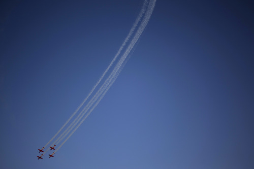 Israeli Air Force acrobatic team T-6 Texan II planes fly during an acrobatics display during a graduation ceremony in the Hatzerim air force base near the southern city of Beersheba, Israel, Thursday, June 27, 2013. (AP Photo/Ariel Schalit)