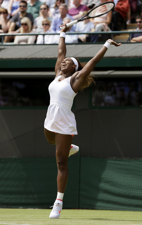 Serena Williams of the United States reacts after scoring a point against Caroline Garcia of France in their Women's second round singles match at the All England Lawn Tennis Championships in Wimbledon, London, Thursday, June 27, 2013. (AP Photo/Alastair Grant)