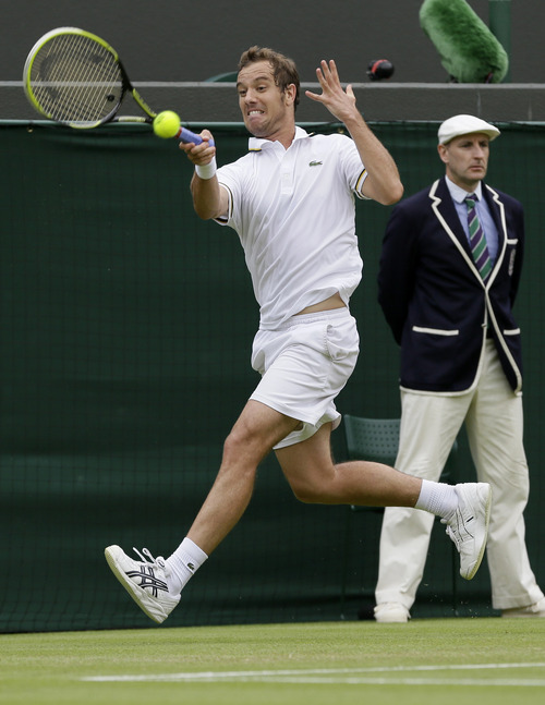 Richard Gasquet of France returns to Go Soeda of Japan during their Men's second round singles match at the All England Lawn Tennis Championships in Wimbledon, London, Thursday, June 27, 2013. (AP Photo/Alastair Grant)