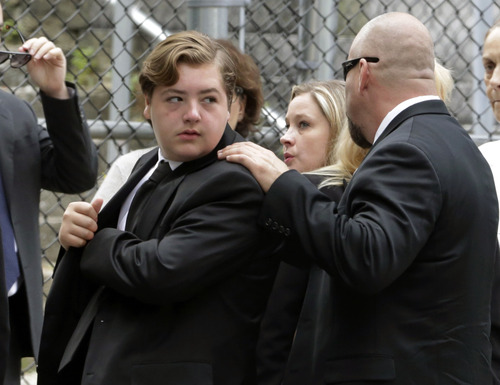 """Michael Gandolfini, left, son of James Gandolfini, arrives for the funeral service of his father, star of """"The Sopranos,"""" in New York's the Cathedral Church of Saint John the Divine,  Thursday, June 27, 2013. The 51-year-old actor died of a heart attack last week while vacationing in Italy with his son.(AP Photo/Richard Drew)"""