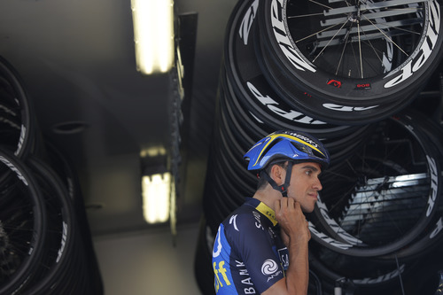Spain's Alberto Contador adjusts his helmet as he leaves for a training ride in Porto Vecchio, southern Corsica island, France, Thursday June 27, 2013. The race starts in Porto Vecchio on Saturday June 29, and the 198-rider peloton, or pack, is to cover 3,479 kilometers (2,162 miles) over three weeks, 21 stages and two rest days, before an unusual nighttime finish July 21 on the Champs-Elysees in Paris. (AP Photo/Laurent Cipriani)