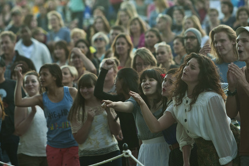 Chris Detrick  |  The Salt Lake Tribune Fans dance and sing as She & Him, Zooey Deschanel and M. Ward, perform at Red Butte Garden Amphitheatre during the 2013 Outdoor Concert Series Tuesday June 25, 2013.