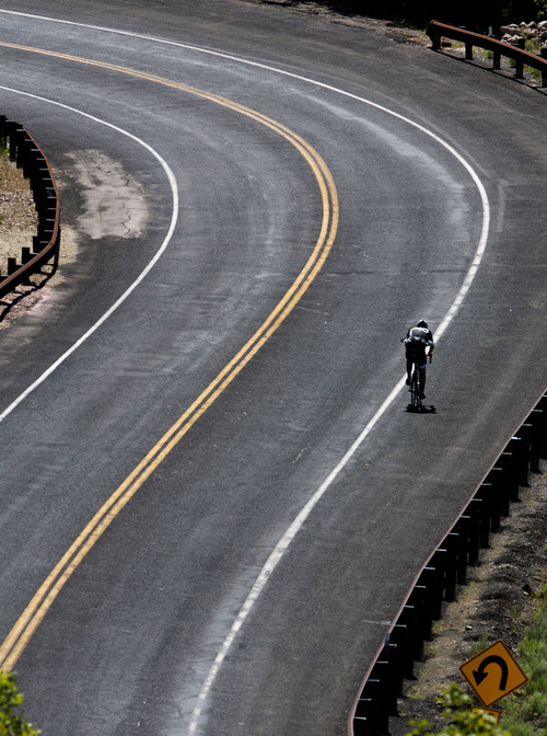 Steve Griffin | The Salt Lake Tribune A bicycle rider braves the heat while riding up Emigration Canyon in Salt Lake City Thursday June 27, 2013.