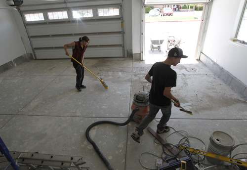 Al Hartmann  |  The Salt Lake Tribune Spartan House built from the ground up by Murray High School students is nearly finished.   Students are laying carpet and sweeping out the double garage preparing final touches for an open house.