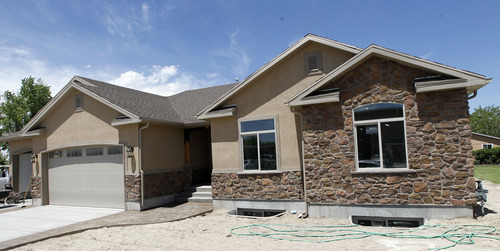 Al Hartmann  |  The Salt Lake Tribune Spartan House built from the ground up by Murray High School students is nearly finished. Students are laying carpet and preparing final touches for an open house.