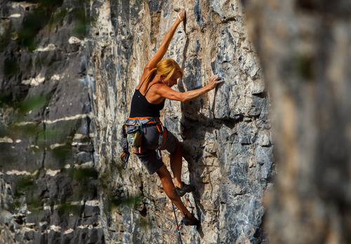 Trent Nelson  |  The Salt Lake Tribune Mindy Shulak climbs the Division Wall in American Fork Canyon.