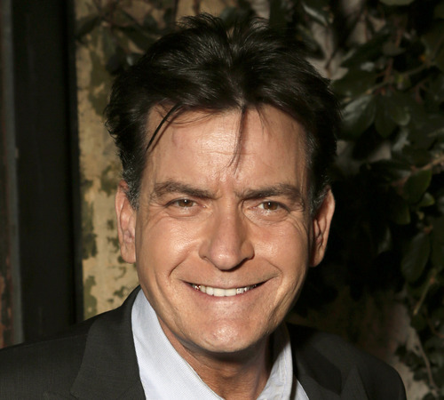 FILE - This June 26, 2012 file photo shows actor Charlie Sheen attending the FX Summer Comedies Party at Lure in Los Angeles. He recently fired co-star Selma Blair from the show via an obscene text message. (Photo by Todd Williamson/Invision/AP, File)