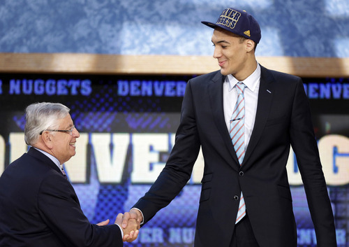 NBA Commissioner David Stern, left, shakes hands with Rudy Gobert, of France, who was selected by the Denver Nuggets in the first round of the NBA basketball draft, Thursday, June 27, 2013, in New York. (AP Photo/Kathy Willens)