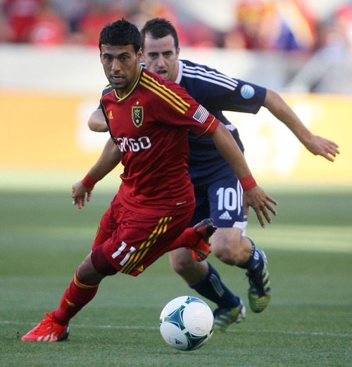 Steve Griffin | The Salt Lake Tribune   RSL's Javier Morales races ahead of Carolina's Claran O'Brien during the RSL versus Carolina Railhawks game in the U.S. Open Cup at Rio Tinto Stadium in Sandy, Utah Wednesday June 26, 2013.