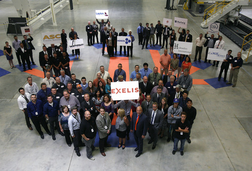 Scott Sommerdorf   |  The Salt Lake Tribune Newly hired Exelis employees, foreground, pose at Excelis Aerostructures, with other new sub-contractors after a press conference where Gov. Gary Herbert announced that the administration's goal of creating 100,000 jobs in 1,000 days is on track midway thru the challenge. The private sector has already created 63,600 jobs. In Herbert's 2012 State of the State address, he challenged the private sector to create 100,000 jobs in 1,000 days.