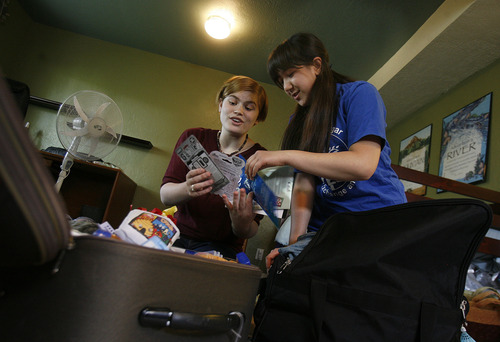 Scott Sommerdorf   |  The Salt Lake Tribune Highland High School student Brianna Lewis, left, and Maryam Shehab look over their luggage as they both are packing for seperate trips soon. Lewis will leave Utah later this month to spend her junior year in India as [art of the Kennedy-Lugar Youth Exchange and Study (YES) Program. Meanwhile, Maryam Shehab, a student from Kuwait who lived with the Lewis family for the past school year will leave soon to return to Kuwait, Wednesday, June 12, 2013.