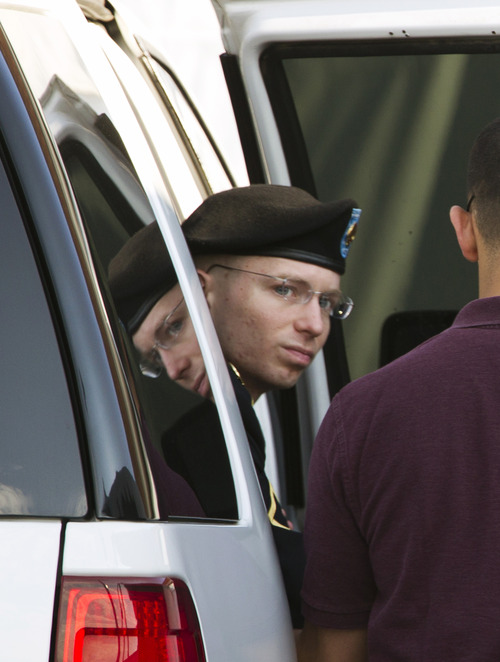 Army Pfc. Bradley Manning arrives at the courthouse in Fort Meade, Md., Friday, June 28, 2013, for his court-martial. Manning is charged with indirectly aiding the enemy by sending troves of classified material to WikiLeaks. He faces up to life in prison. ( AP Photo/Jose Luis Magana)