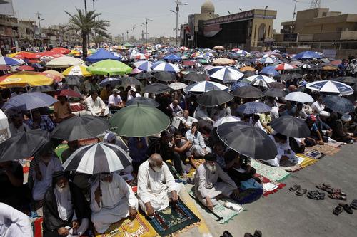 Followers of radical Shiite cleric Muqtada al-Sadr attend Friday prayers in the Sadr City neighborhood in Baghdad, Iraq, Friday, June 28, 2013. (AP Photo/Karim Kadim)