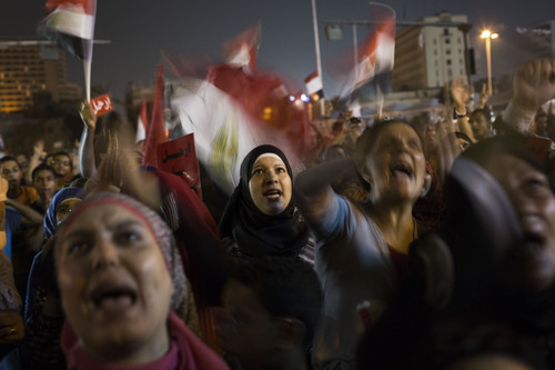Egyptian women chant slogans against President Mohammed Morsi during a demonstration in in Tahrir Square in Cairo, Thursday, June 27, 2013. Cairo is bracing for mass protests against the government planned for Sunday. (AP Photo/  Manu Brabo)