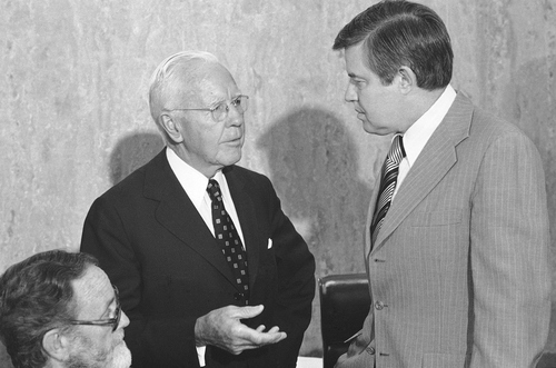 Former CIA Director John McCone, left, chats with Sen. Frank Church (D-Idaho), chairman of the Senate Intelligence Committee, prior to hearings on intelligence activities in Washington, June 6, 1975. (AP Photo/Henry Griffin)