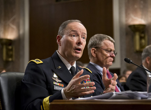 Gen. Keith B. Alexander, director of the National Security Agency and head of the U.S. Cyber Command, answers questions from lawmakers on Capitol Hill in Washington, Wednesday, June 12, 2013, before the Senate Appropriations Committee. It is his first public appearance before Congress since revelations that the electronic surveillance agency is sweeping up Americans' phone and Internet records in its quest to investigate terrorist threats. At right is Rand Beers, under secretary for the Department of Homeland Security. (AP Photo/J. Scott Applewhite)