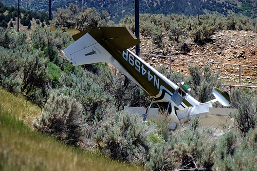 Donald W. Meyers  |  The Salt Lake Tribune  Utah County Sheriff's Office personnel investigate the crash of a two-seat aircraft on U.S. Highway 89 south of Birdseye Thursday, June 27, 2013. Sheriff's Lt. Shawn Chipman said the pilot, who was critically injured in the crash, radioed the Spanish Fork airport that his cabin was filling with smoke and was going to attempt an emergency landing on the road. A passenger in the plane was killed on impact, Chipman said. The crash blocked traffic until 1:20 p.m.