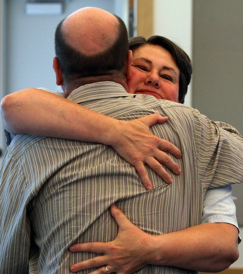 Rick Egan  | The Salt Lake Tribune   Clyde Peck, a member of the Restore Our Humanity board, gets a hug from Kate Call during a press conference. Thursday, June 27, 2013.