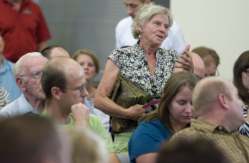 Paul Fraughton  |   The Salt Lake Tribune Ria Van Lent asks a question of representatives of Stericycle, a company that runs a medical waste incinerator in North Salt Lake.   Residents in the community  gathered at North Salt Lake's city hall to ask questions concerning the possible health risks associated with the facility.  Thursday, June 27, 2013