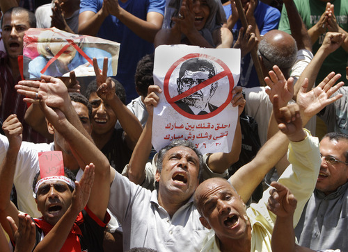 "Egyptian protesters shout anti-Muslim Brotherhood slogans as they hold posters depicting U.S. Ambassador to Egypt Anne Patterson and President Mohammed Morsi during a protest in Tahrir Square, the focal point of Egyptian uprising, in Cairo, Egypt, Friday, June 28, 2013. Arabic on the poster at center reads, ""shave your beard show your shame, you will look like Mubarak."" Egypt's opposition plans to bring out massive crowds on Sunday in protests nationwide, vowing to force President Mohammed Morsi to step down. Across the city from a pro-Morsi rally Friday, thousands massed in Cairo's central Tahrir Square, shouting for the president to ""leave, leave,""(AP Photo/Amr Nabil)"