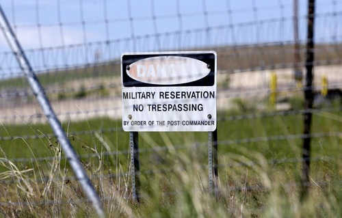 FILE - This June 7, 2013 file photo, shows a military no trespassing sign shown in front of Utah's NSA Data Center in Bluffdale, Utah.  The nation's new billion-dollar epicenter for fighting global cyberthreats sits just south of Salt Lake City, tucked away on a National Guard base at the foot of snow-capped mountains. The long, squat buildings span 1.5 million square feet, and are filled with super-powered computers designed to store massive amounts of information gathered secretly from phone calls and emails. (AP Photo/Rick Bowmer, File)