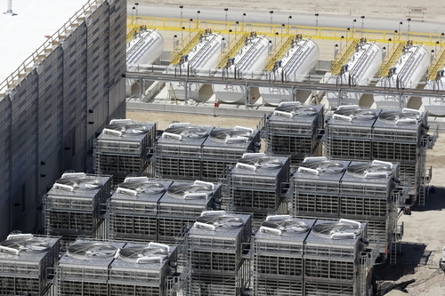 Rick Bowmer | The Associated Press This June 6, 2013, photo, shows an aerial view of the cooling units at the NSA's Utah Data Center in Bluffdale, Utah. The nation's new billion-dollar epicenter for fighting global cyberthreats sits just south of Salt Lake City, tucked away on a National Guard base at the foot of snow-capped mountains. The long, squat buildings span 1.5 million square feet, and are filled with super-powered computers designed to store massive amounts of information gathered secretly from phone calls and emails.