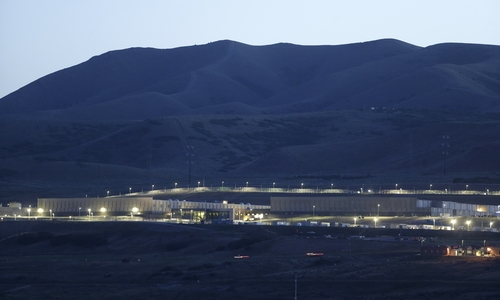 This Monday, June 10, 2013 photo, shows a ground level view of Utah's NSA Data Center in Bluffdale, Utah.  The nation's new billion-dollar epicenter for fighting global cyberthreats sits just south of Salt Lake City, tucked away on a National Guard base at the foot of snow-capped mountains. The long, squat buildings span 1.5 million square feet, and are filled with super-powered computers designed to store massive amounts of information gathered secretly from phone calls and emails. (AP Photo/Rick Bowmer)