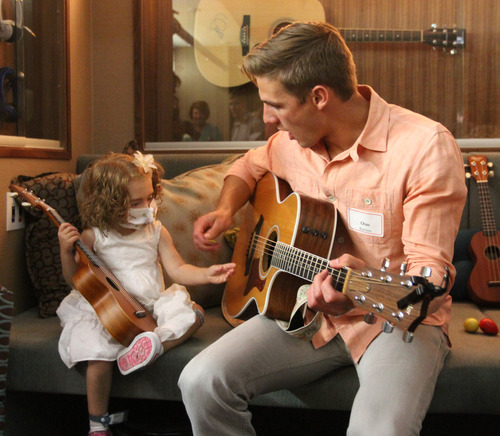 Rick Egan  |  The Salt Lake Tribune Sophie Barton's brother Chas Barton plays guitar with 3-year-old Alice Fish at Sophie's place at Primary Children's Medical Center, Friday, June 28, 2013. Barb and Steve Young and their Forever Young Foundation paid tribute to Sophie Barton -- a local singer-songwriter who died in 2010 at the age of 17 -- by unveiling the music therapy space.