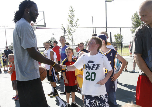 Scott Sommerdorf   |  The Salt Lake Tribune Young Jazz fans get to meet Jazz player DeMarre Carroll as he works with kids in Brigham City during a Jr. Jazz appearance, Friday, June 28, 2013.