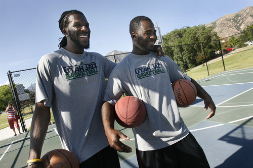 Scott Sommerdorf   |  The Salt Lake Tribune Jazz player DeMarre Carroll, left, chuckles as he watches kids work out with his cousin Deondre Collins. They both worked with kids in Brigham City during a Jr. Jazz appearance, Friday, June 28, 2013.
