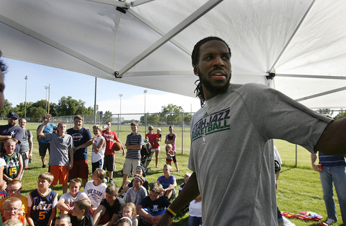 Scott Sommerdorf   |  The Salt Lake Tribune Jazz player DeMarre Carroll answers questions from kids in Brigham City during a Jr. Jazz appearance, Friday, June 28, 2013.
