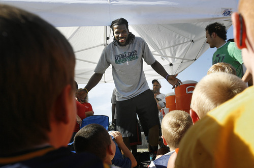 Scott Sommerdorf   |  The Salt Lake Tribune Jazz player DeMarre Carroll jokes with kids as he answers their questions from in Brigham City during a Jr. Jazz appearance, Friday, June 28, 2013. He explained that he loved the Teenage Mutant Ninja Turtles as a kid.
