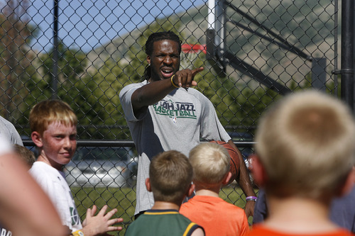 Scott Sommerdorf   |  The Salt Lake Tribune Jazz player DeMarre Carroll works with kids in Brigham City during a Jr. Jazz appearance, Friday, June 28, 2013.