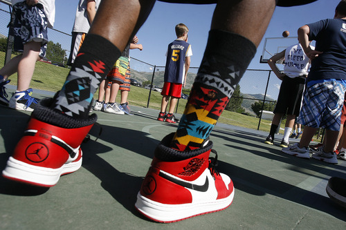 Scott Sommerdorf   |  The Salt Lake Tribune Jazz player DeMarre Carroll is a sock collector. He said he has over 350 pairs to go with his close to 700 pair of shoes. Here, he works with kids in Brigham City during a Jr. Jazz appearance, Friday, June 28, 2013.