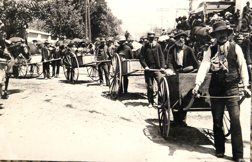 (Salt Lake Tribune archives)  Men pulling hand carts in the July 24th parade of 1897 in Salt Lake City.