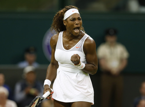 Serena Williams of the United States reacts as she plays Kimiko Date-Krumm of Japan during their Women's singles match at the All England Lawn Tennis Championships in Wimbledon, London,  Saturday, June 29, 2013. (AP Photo/Sang Tan)