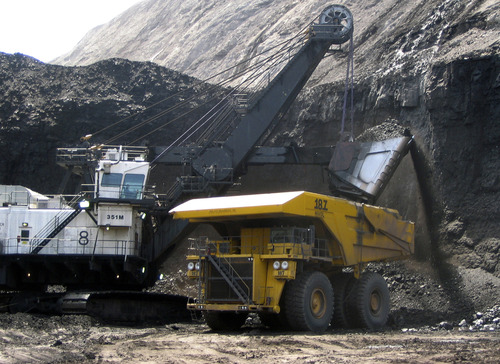 (AP Photo/Matthew Brown, File) A tradeoff in the the effort to recuce emissions is that the proposed  regulations could increase utility costs for American consumers and harm regional economies tied to coal, which generates about 37 percent of all U.S. electricity.