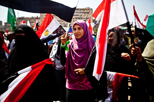 Women attend a rally to support Egyptian President Mohammed Morsi in Nasser City, Cairo, Sunday, June 30, 2013. Thousands of opponents and supporters of Egypt's Islamist president began massing in city squares in competing rallies Sunday, gearing up for a day of massive nationwide protests that many fear could turn deadly as the opposition seeks to push out Mohammed Morsi.(AP Photo/Virginie Nguyen Hoang)