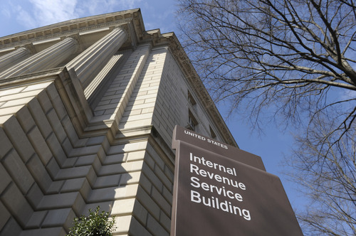 FILE - This March 22, 2013 file photo shows the exterior of the Internal Revenue Service building in Washington. Just like other married couples, same-sex couples are about to find out that federal benefits for being married might not be all they're cracked up to be. Social Security benefits for spouses can be generous, but only for couples with big disparities in their incomes. Taxes are a decidedly mixed bag, and there still a lot of unanswered questions for the Internal Revenue to address. (AP Photo/Susan Walsh, File)
