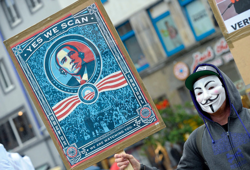 """In this picture, taken Saturday June 29, 2013, a  demonstrator protests with a poster against NSA  in Hanover, Germany.  Germany's top justice official says reports that U.S. intelligence bugged European Union offices remind her of """"the methods used by enemies during the Cold War.""""   Justice Minister Sabine Leutheusser-Schnarrenberger was responding to a report by German news weekly Der Spiegel on Sunday June 30, 2013,  that claimed the National Security Agency has eavesdropped on EU offices in Washington, New York and Brussels.  The magazine cited classified U.S. documents taken by NSA leaker Edward Snowden that it said it had partly seen.  The documents reportedly describe the European Union as a """"target"""" for surveillance.  (AP Photo/dpa, Peter Steffen)"""