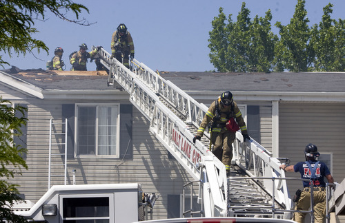 Kim Raff  |  The Salt Lake Tribune Salt Lake City firefighters work to put out a fire in an apartment building at the Park City Apartments off of 900 West in Salt Lake City on June 30, 2013.