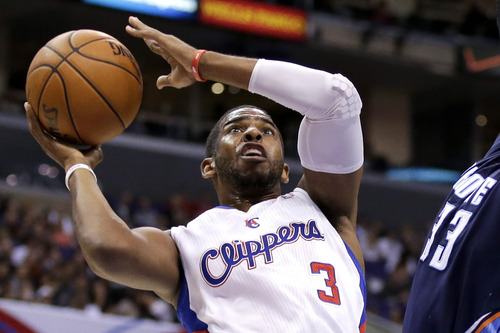 FILE - In this Feb. 27, 2013 file photo, Los Angeles Clippers guard Chris Paul plays against the Charlotte Bobcats during an NBA basketball game in Los Angeles. Paul is staying with the Clippers. The All-Star point guard agreed to a new deal on the first day free agency opened, agent Leon Rose confirms, Monday July 1, 2013. (AP Photo/Chris Carlson)