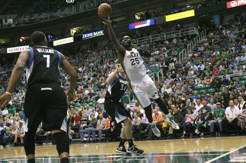 Chris Detrick  |  The Salt Lake Tribune Utah Jazz center Al Jefferson (25) shoots past Minnesota Timberwolves center Greg Stiemsma (34) during the first half of the game at EnergySolutions Arena Friday April 12, 2013. Minnesota Timberwolves are winning the game 54-53 at halftime.