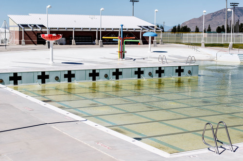 Trent Nelson     The Salt Lake Tribune The large swimming pool at the Desert Peaks Complex sits empty Thursday June 20, 2013 in Tooele. Tooele county is struggling to cope with cuts as the county tries to recover from the economic downturn and a hole in federal revenue because federal programs are clearing out their warehouses in Tooele.