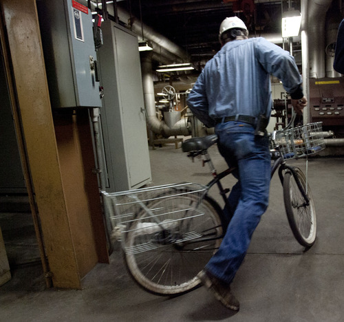Steve Griffin | The Salt Lake Tribune  An employee gets off the elevator on a bicycle inside the Intermountain Power Plant near Delta, Utah Friday April 12, 2013.