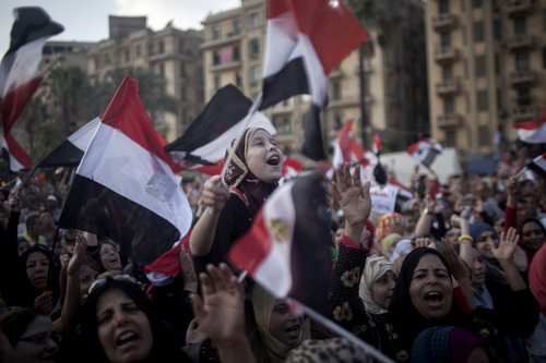 "An Egyptian girl chants slogans at a demonstration against Egypt's Islamist President Mohammed Morsi during a rally in Tahrir Square in Cairo, Monday, July 1, 2013. Egypt's powerful military warned on Monday it will intervene if the Islamist president doesn't ""meet the people's demands,"" giving him and his opponents two days to reach an agreement in what it called a last chance. Hundreds of thousands of protesters massed for a second day calling on Mohammed Morsi to step down. (AP Photo/ Manu Brabo)"