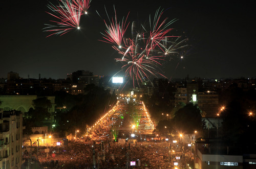 "Fireworks light the sky as opponents of Egypt's Islamist President Mohammed Morsi protest outside the presidential palace in Cairo, Egypt, Monday, July 1, 2013. Egypt's powerful military warned on Monday it will intervene if the Islamist president doesn't ""meet the people's demands,"" giving him and his opponents two days to reach an agreement in what it called a last chance. Hundreds of thousands of protesters massed for a second day calling on Mohammed Morsi to step down. (AP Photo/Khalil Hamra)"