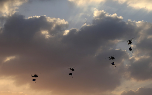 "Military helicopters fly over the presidential palace, in Cairo, Egypt, Monday, July 1, 2013. Egypt's military on Monday issued a 48-hour ultimatum to the Islamist president and his opponents to reach an agreement to ""meet the people's demands"" or it will intervene to put forward a political road map for the country and ensure it is carried out. (AP Photo/Hassan Ammar)"